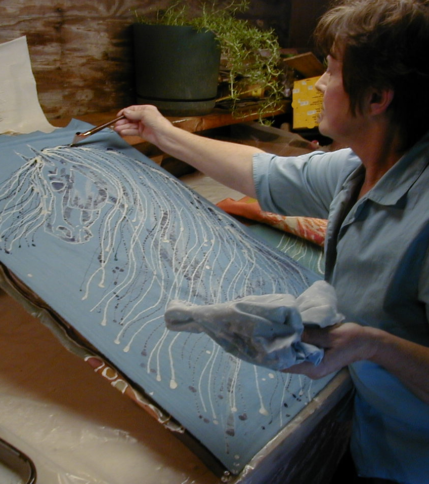 Carol works on blue horse