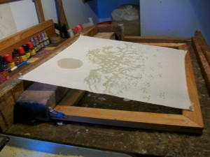 Fabric stretched and painted with the first stage of wax on a batik