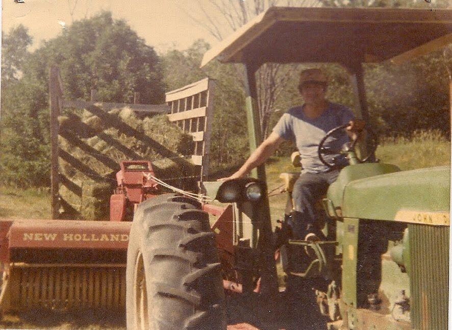 Dick baling hay