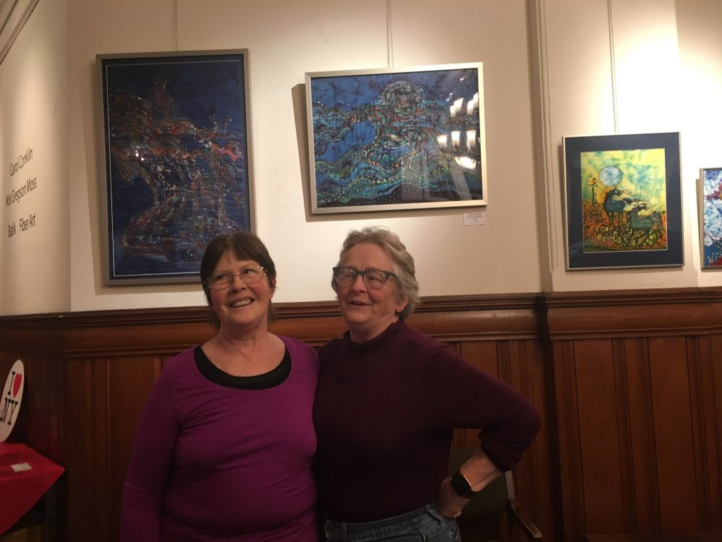 Carol Law Conklin and Kris Gregson Moss in front of their artwork
